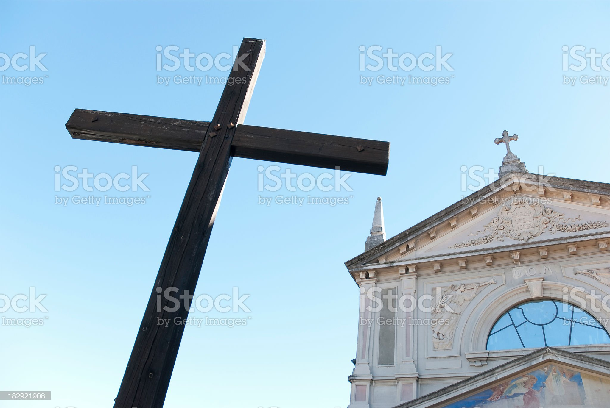 Crucifix Against A Church royalty-free stock photo