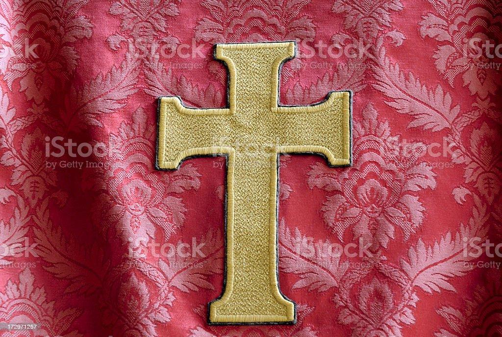 Crucifix against fabric stock photo