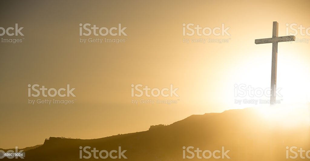 Crucifix at sunrise on Easter morning- copy space stock photo