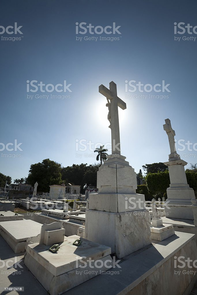 Crucifix Headstone in Christian Cemetery royalty-free stock photo