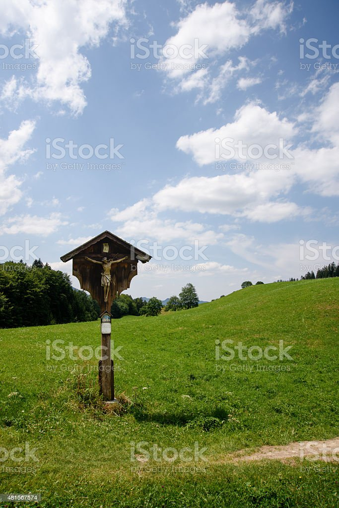 Crucifix in a summer meadow stock photo