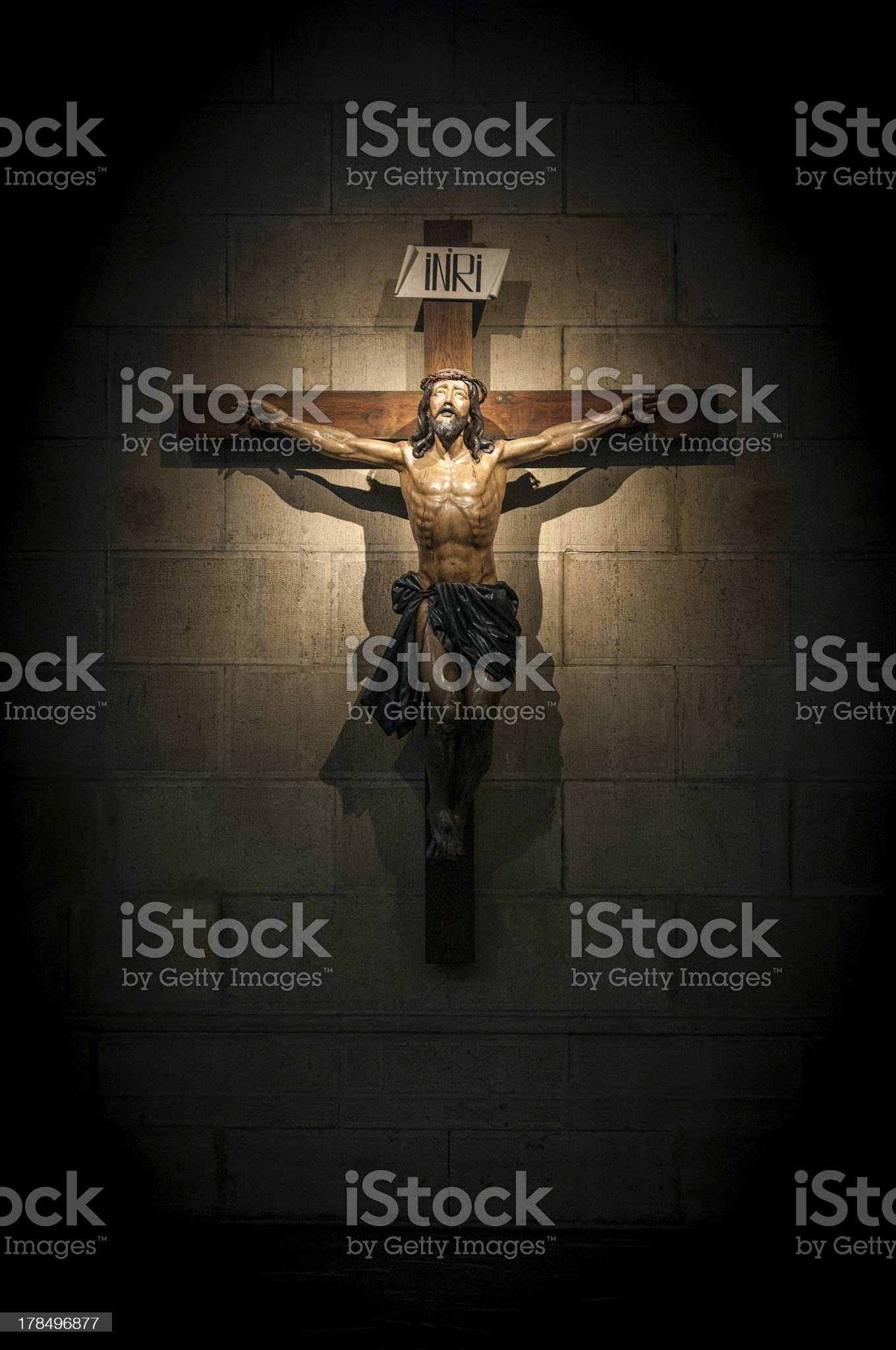 Crucifix in church on the stone wall. royalty-free stock photo