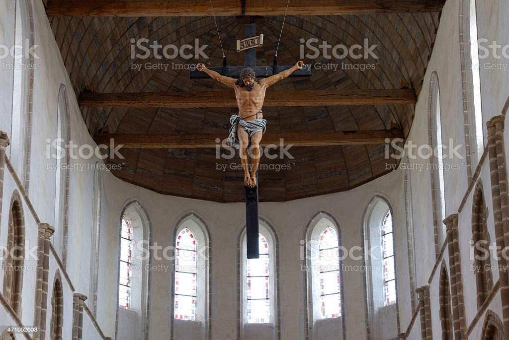 crucifix in medieval church stock photo