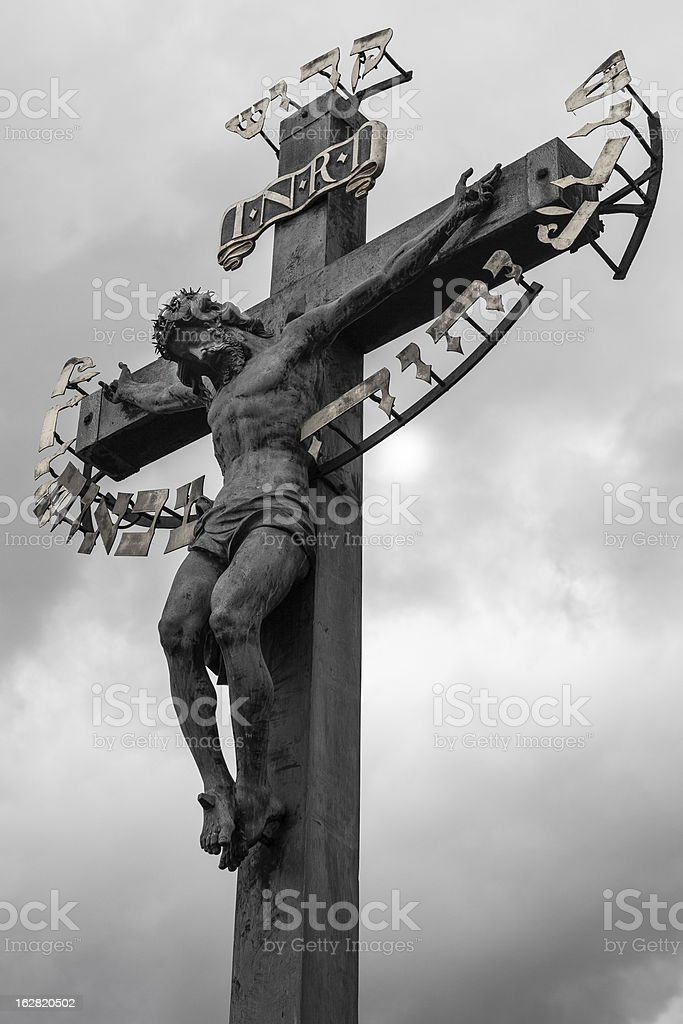 Crucifix on Charles Bridge in Prague royalty-free stock photo