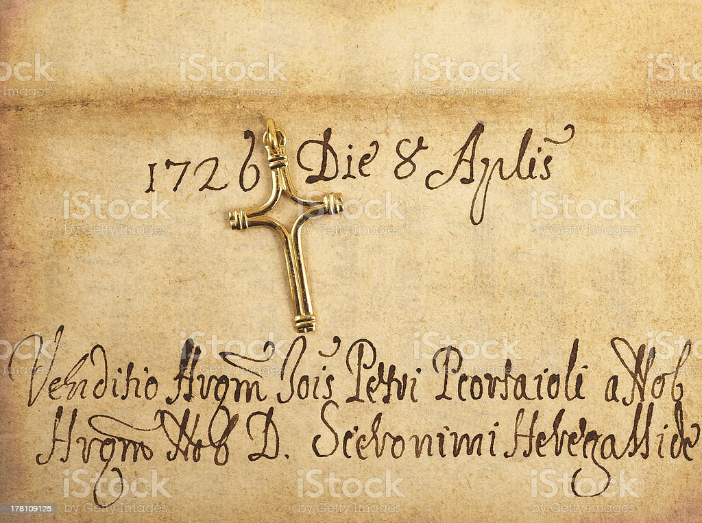 crucifix on parchment royalty-free stock photo