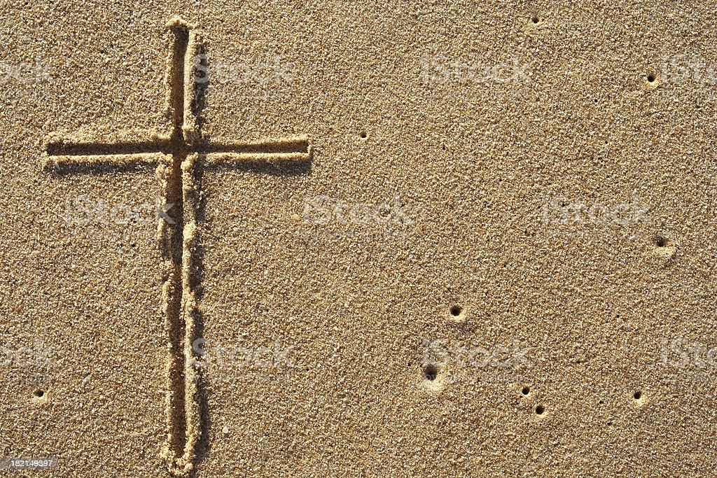 crucifix on sand royalty-free stock photo