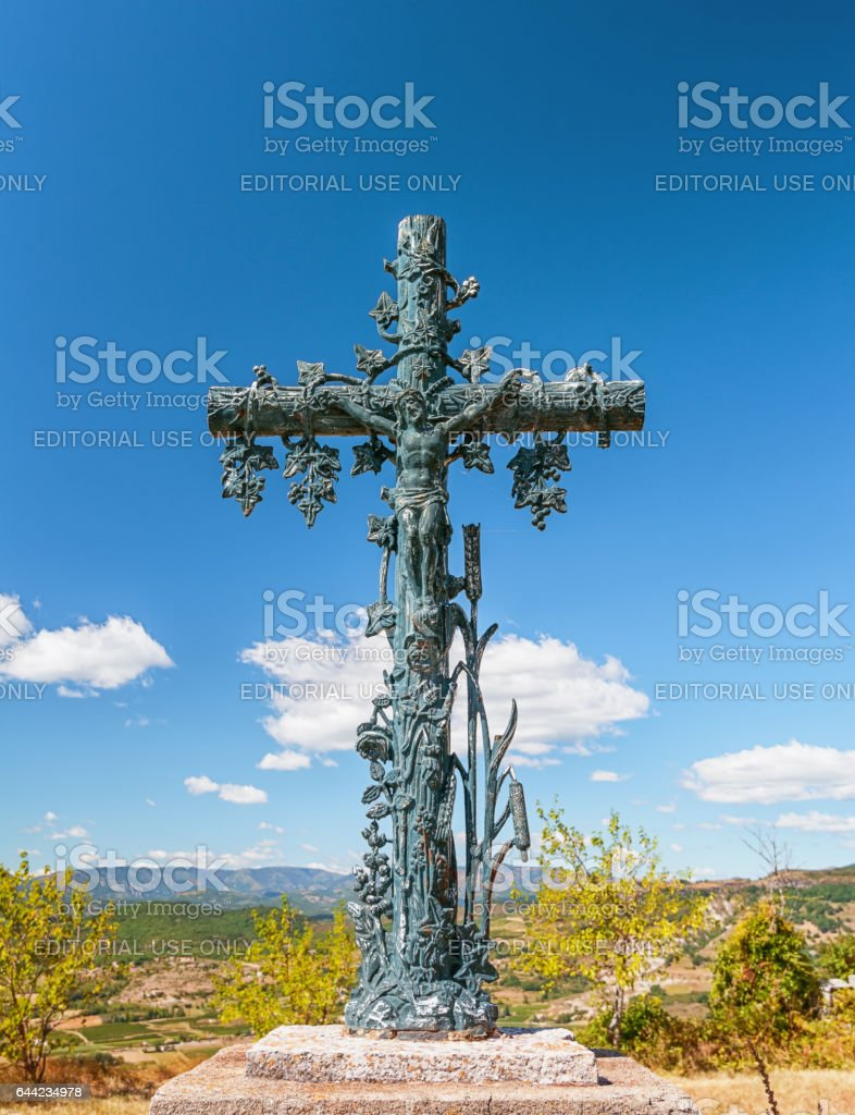 Crucifixion of Christ in front of the village stock photo