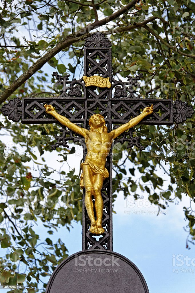 crucifixion of jesus christ - golden crucifix stock photo
