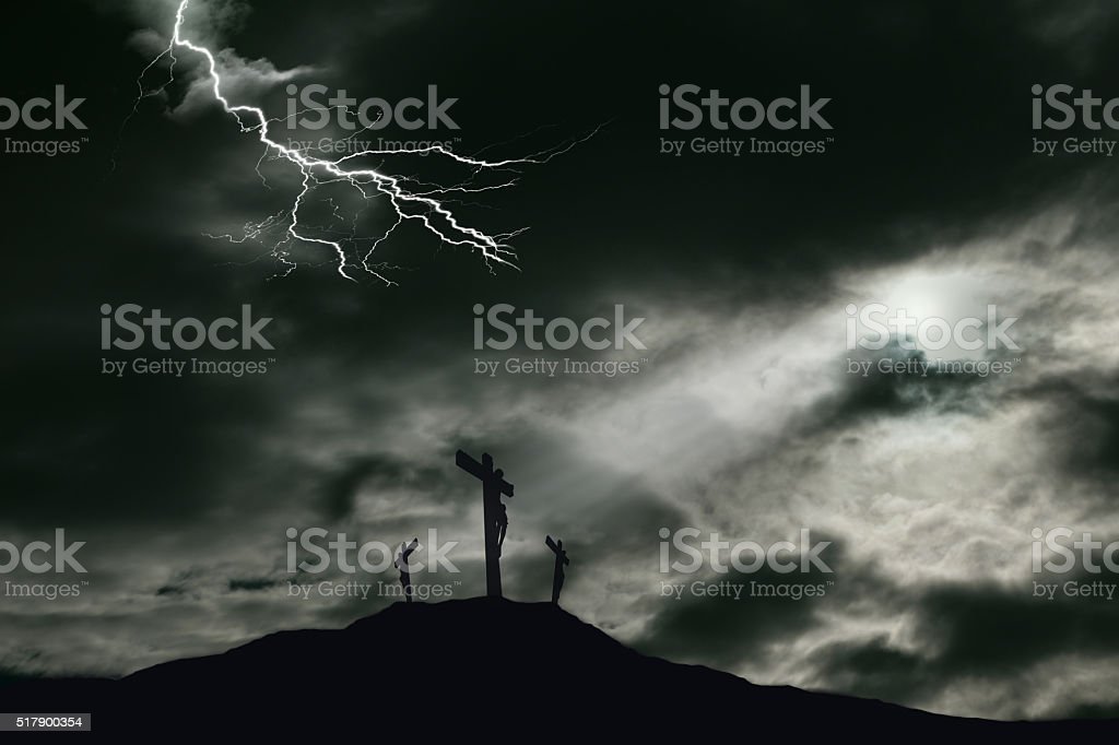 A depiction of the crucifixion of Jesus Christ on a cross with 2...