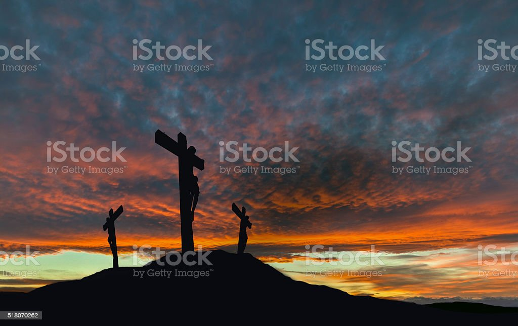 Crucifixion of Jesus With Dramatic Sky and Copy Space stock photo