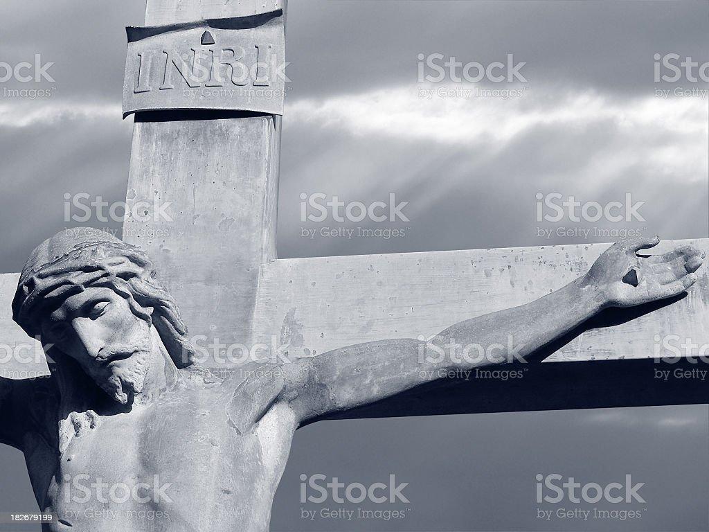 Crucifixion under a dark sky - black & white royalty-free stock photo