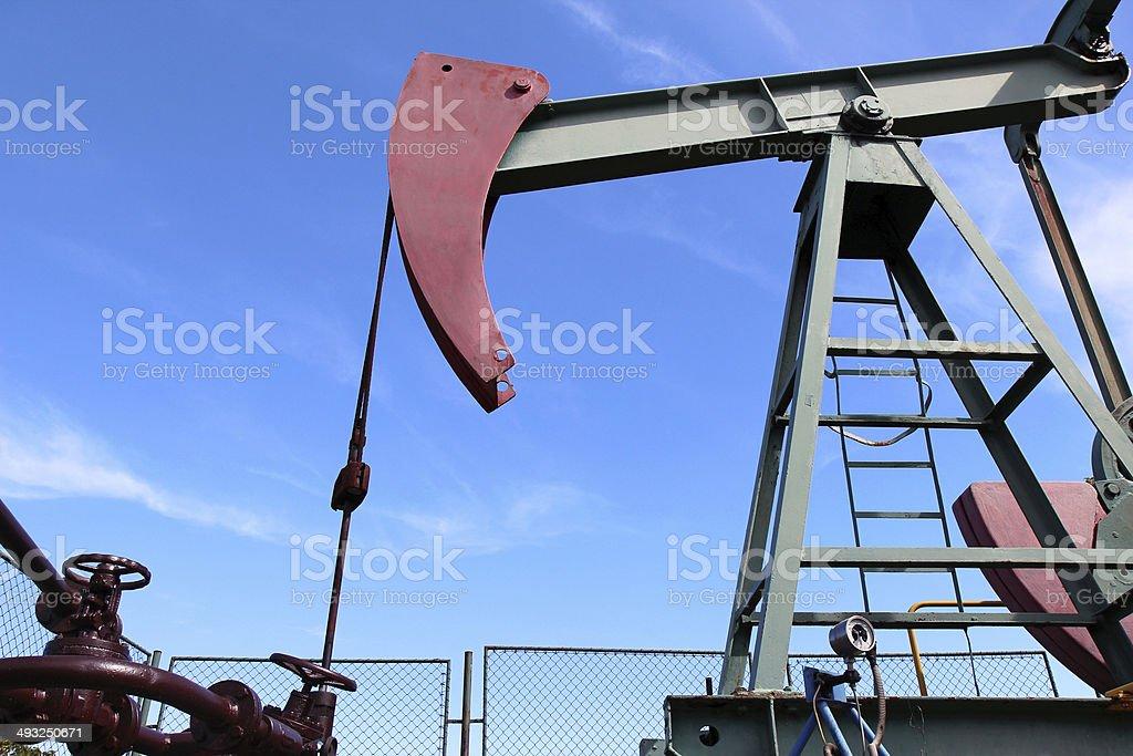 crude oil  jack pump under blue sky in europe stock photo