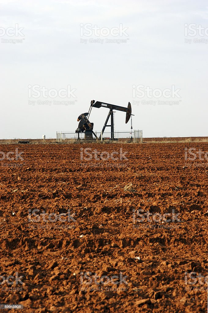 crude oil pump in plowed field royalty-free stock photo