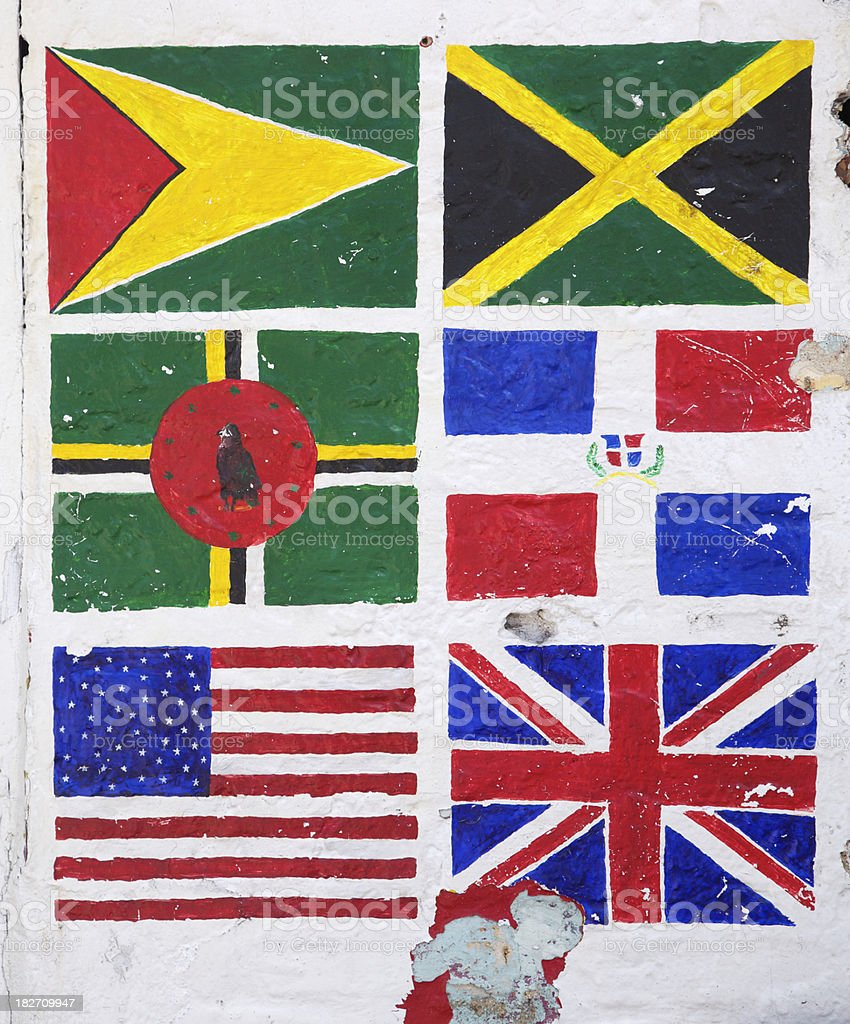 Crudely Painted Flags on White Wall, Grunge, Caribbean royalty-free stock photo