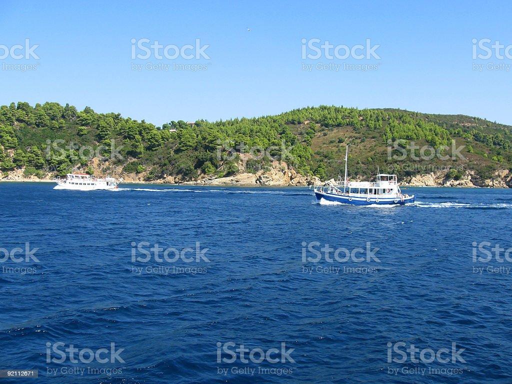 Cruise boats near land stock photo