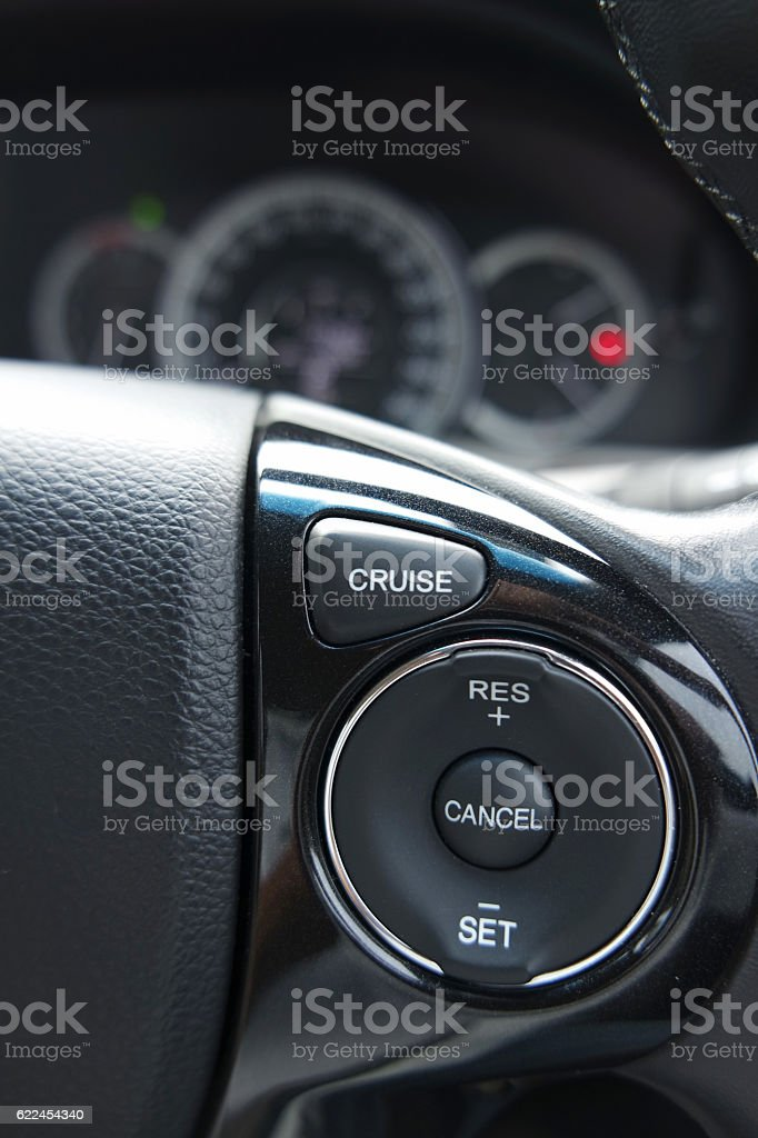 Cruise control buttons installed to the car's steering wheel stock photo