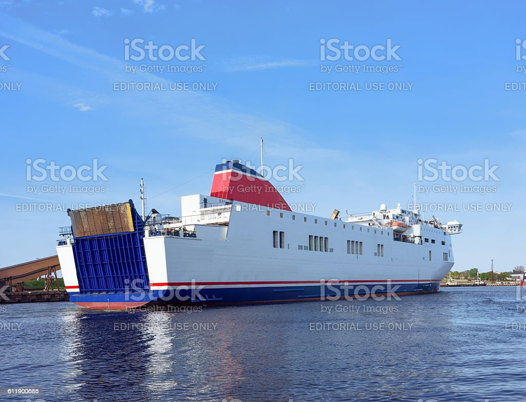 Cruise liner on the Venta River in Ventspils of Latvia stock photo