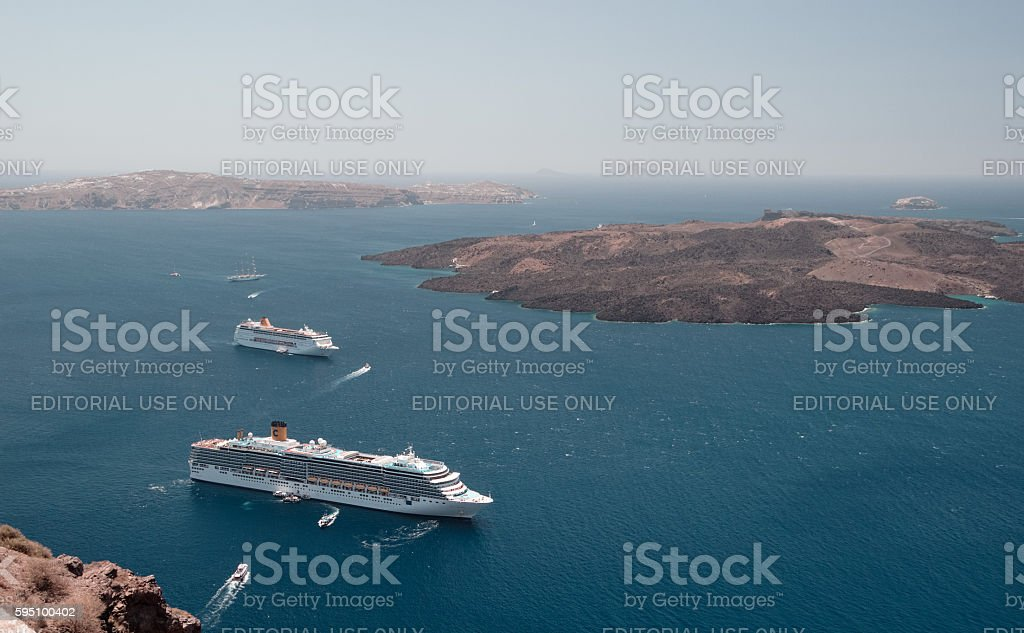 Cruise liners at anchor in the Santorini lagoon. stock photo