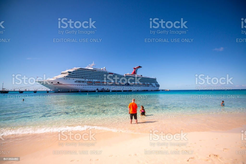 Cruise Ship and tourists relaxing  on Grand Turk Island, Turks and Caicos stock photo
