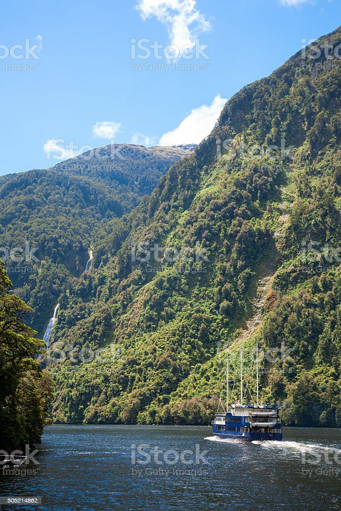 Cruise ship at Fiordland in New Zealand stock photo