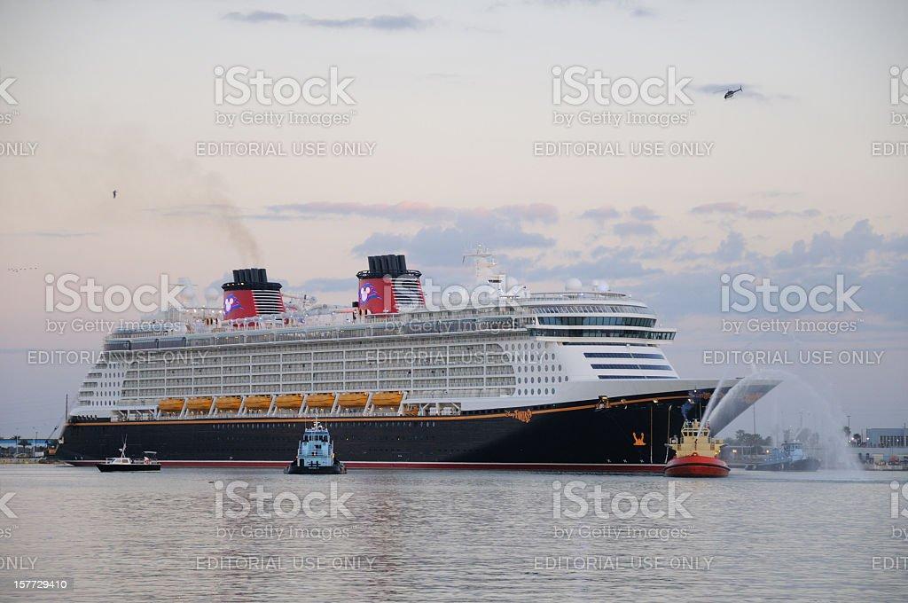 Cruise Ship Disney Fantasy with tugs stock photo