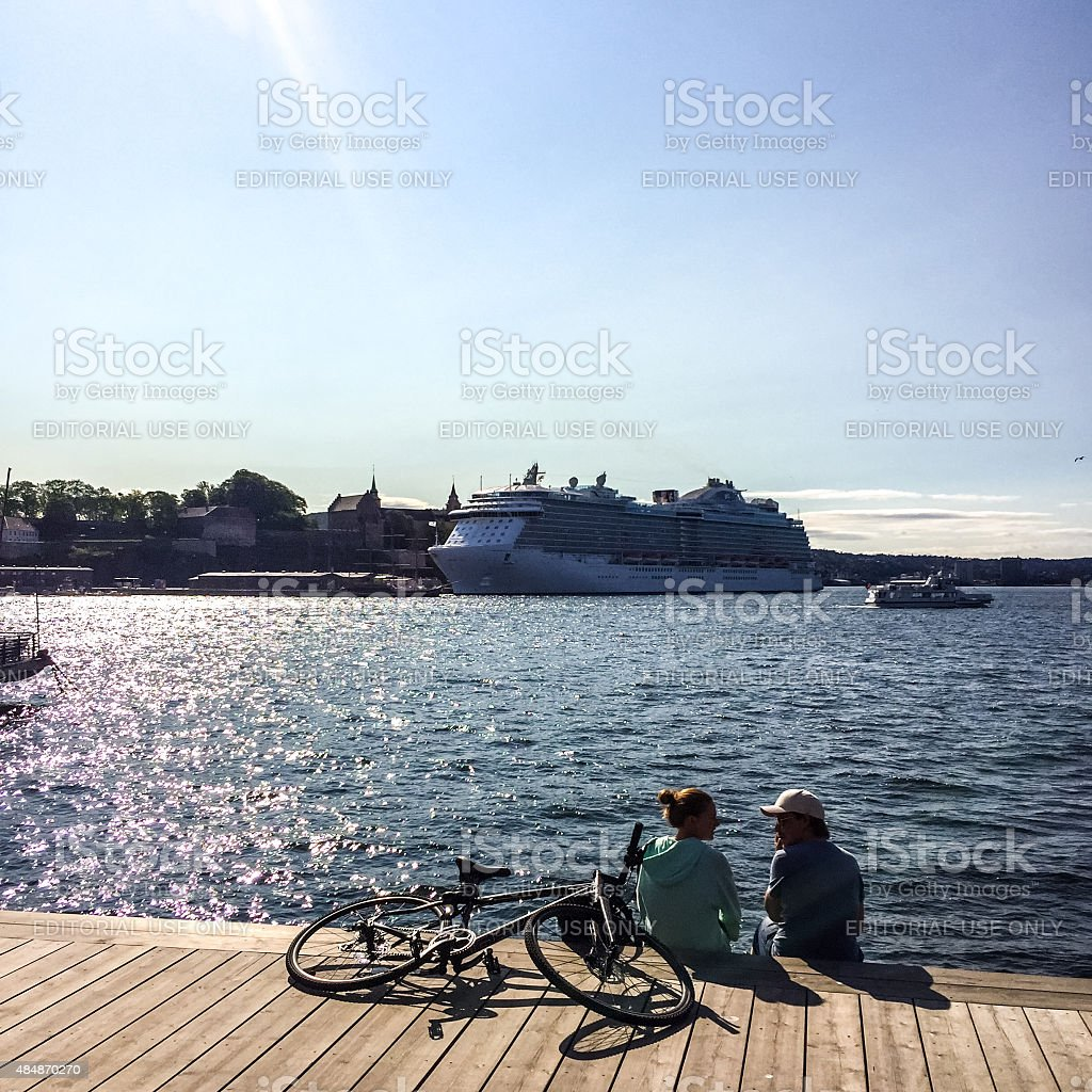 Cruise Ship in Oslo Harbor and people enjoying the view stock photo