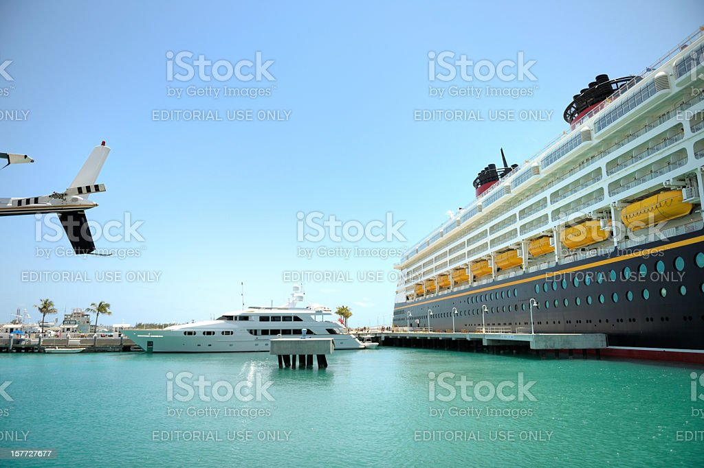 cruise ship, luxury recreational boat and helicopter in port royalty-free stock photo