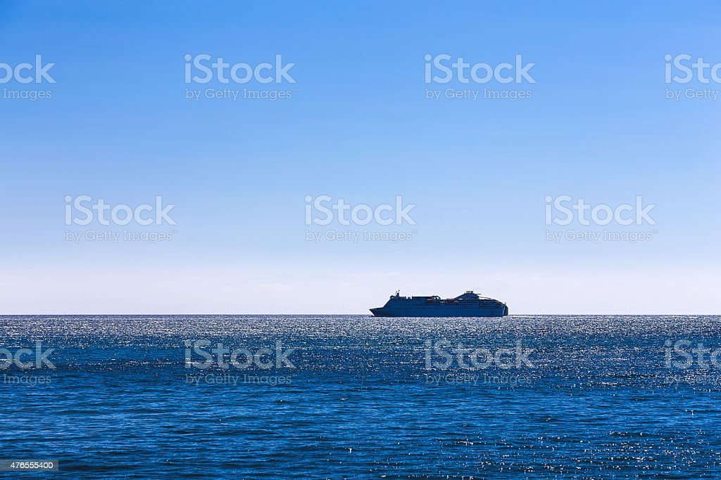 Cruise ship or liner in open ocean stock photo