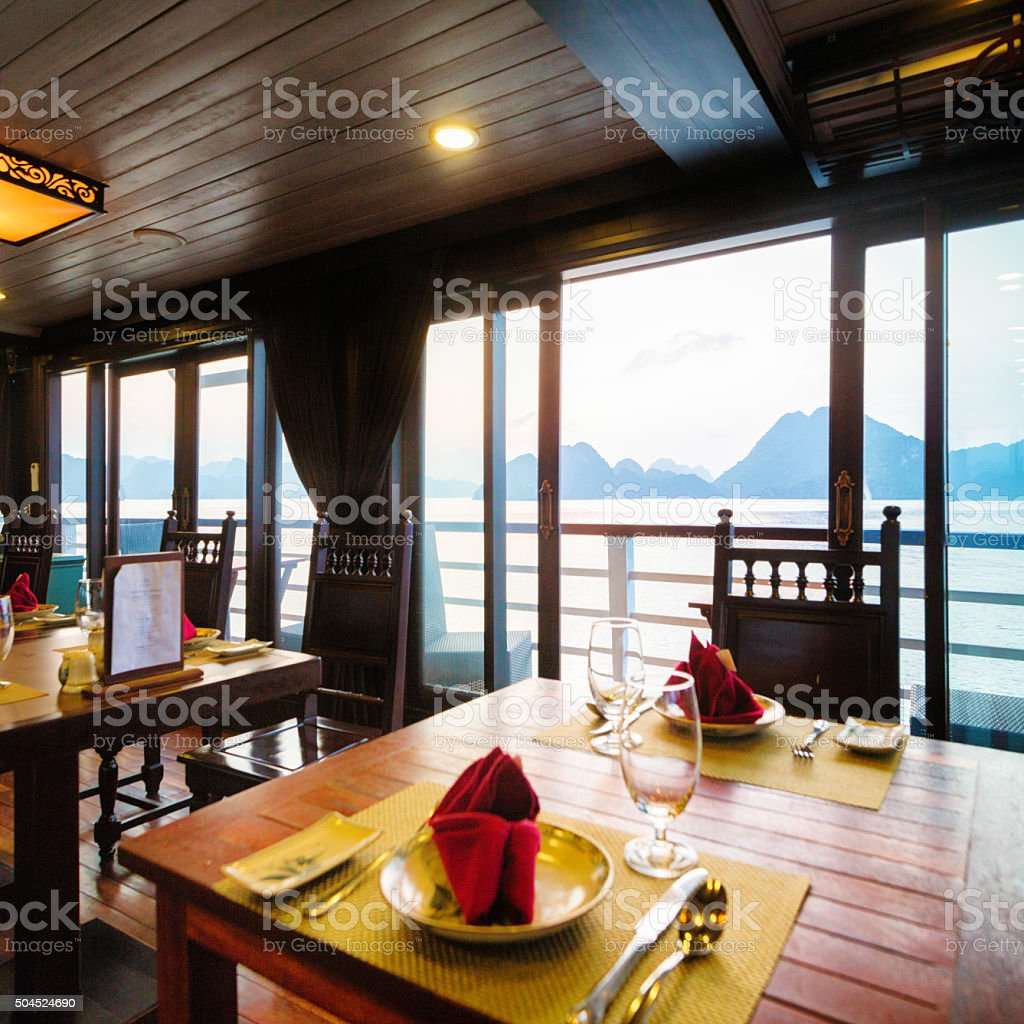 Cruise ship restaurant table  with view of Halong Bay Vietnam stock photo
