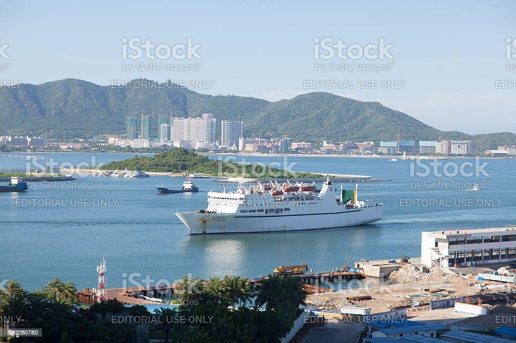 Cruise ship returning to Sanya, Hainan Island, China stock photo