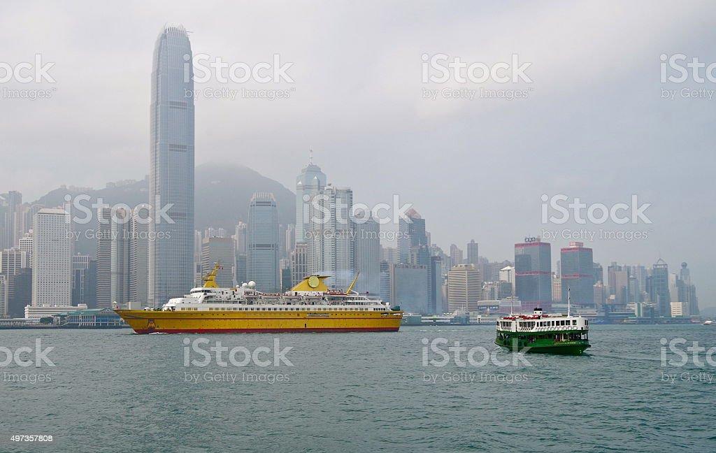 Cruise ship sailing past Hong Kong skyline stock photo