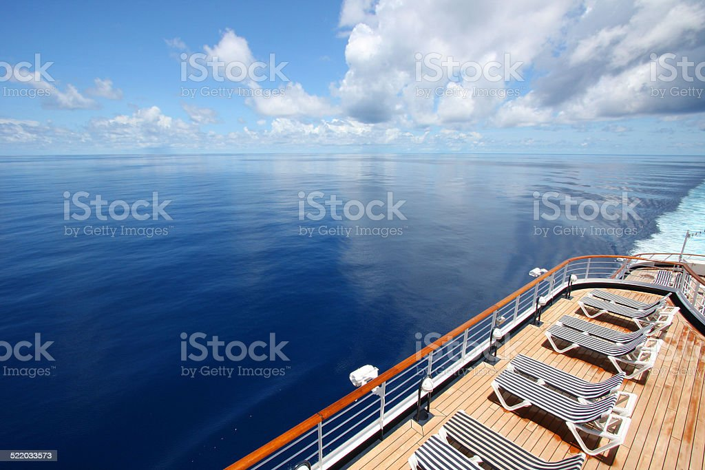 Cruise ship sails across a beautiful calm ocean. stock photo