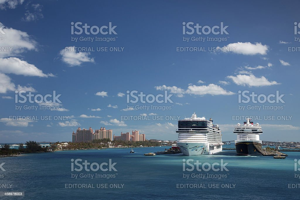 Cruise ships docked in Nassau while guests enjoying sightseeing. stock photo