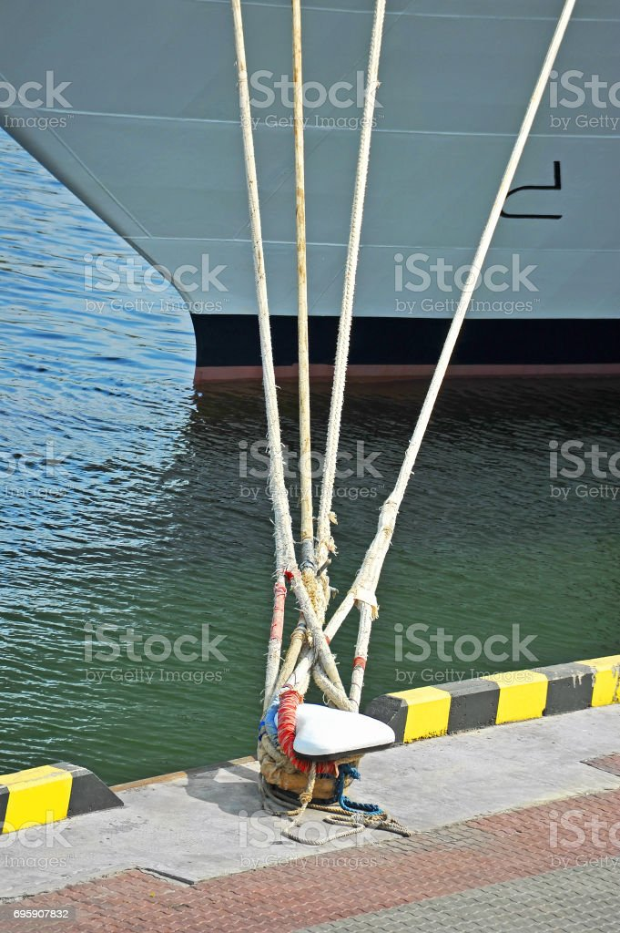 Cruise travel ship and bollard stock photo