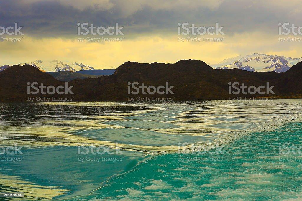 Cruise waves on Pehoe Lake, dramatic evening  - Chilean Patagonia stock photo