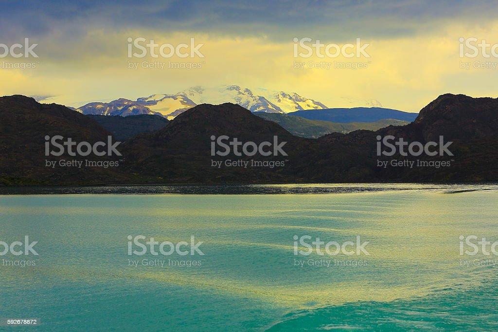 Cruise waves on Pehoe Lake, dramatic sunset clouds, Patagonia stock photo