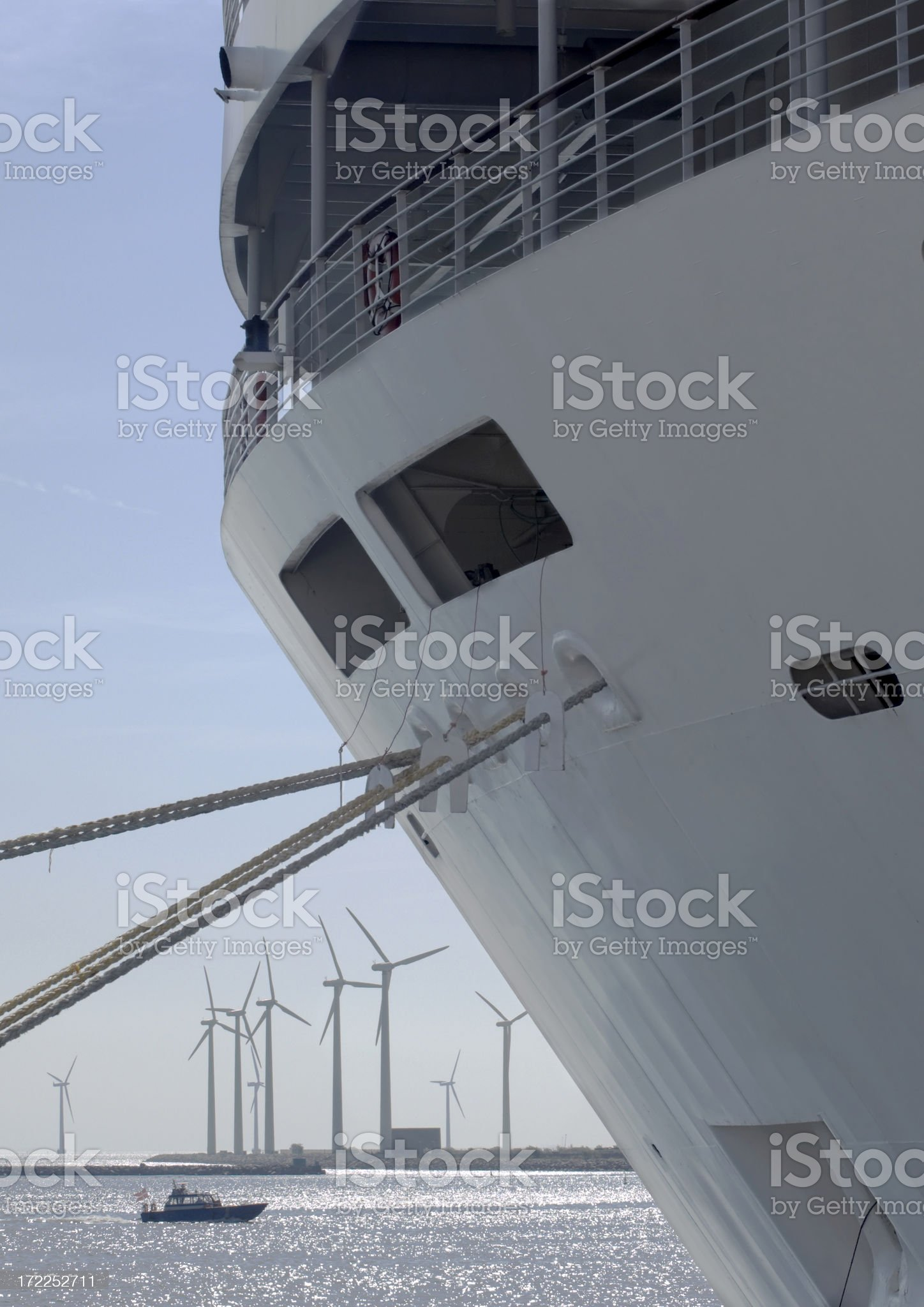 Cruiseship and windmills royalty-free stock photo