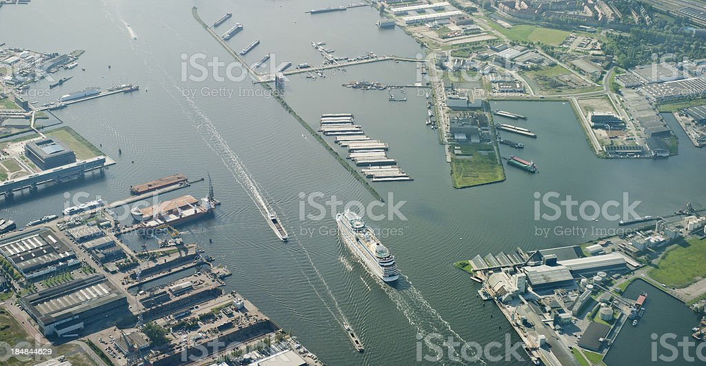 cruiseship entering the harbor of Amsterdam stock photo