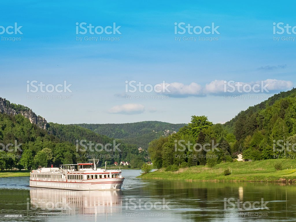 Cruising ship on a river on a sunny day stock photo