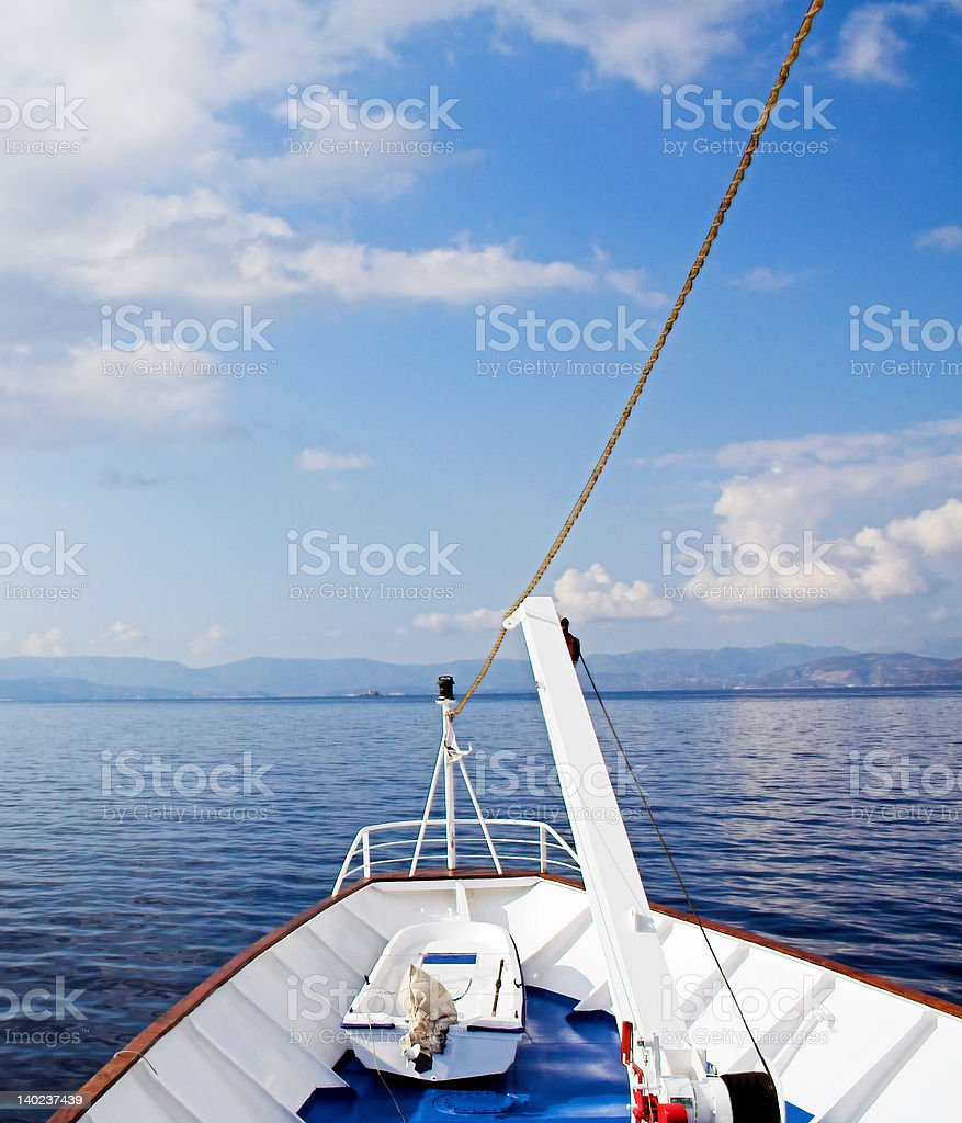 Cruising the blue sea and sky stock photo
