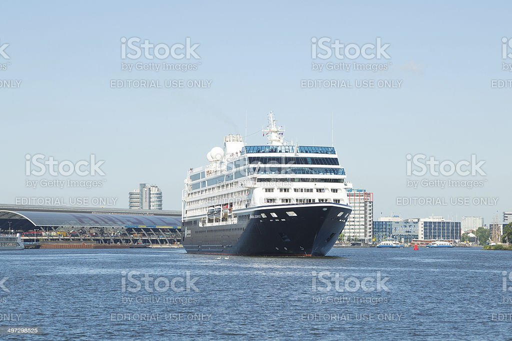Cruisship enters the Harbor of Amsterdam stock photo