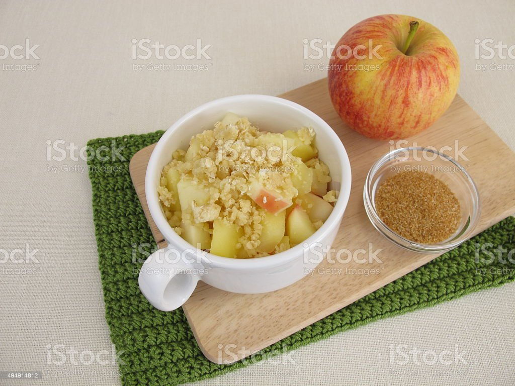 Crumble mug cake with apple and cinnamon sugar stock photo