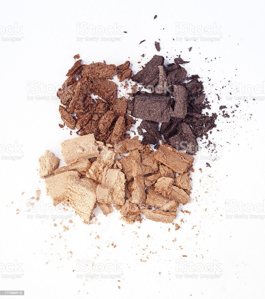 Crumbled eyeshadow powder in four colors stock photo