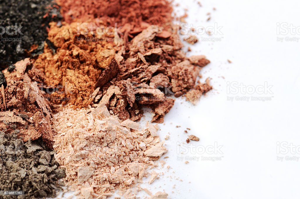 crumbled eyeshadows of different colors on a white background stock photo