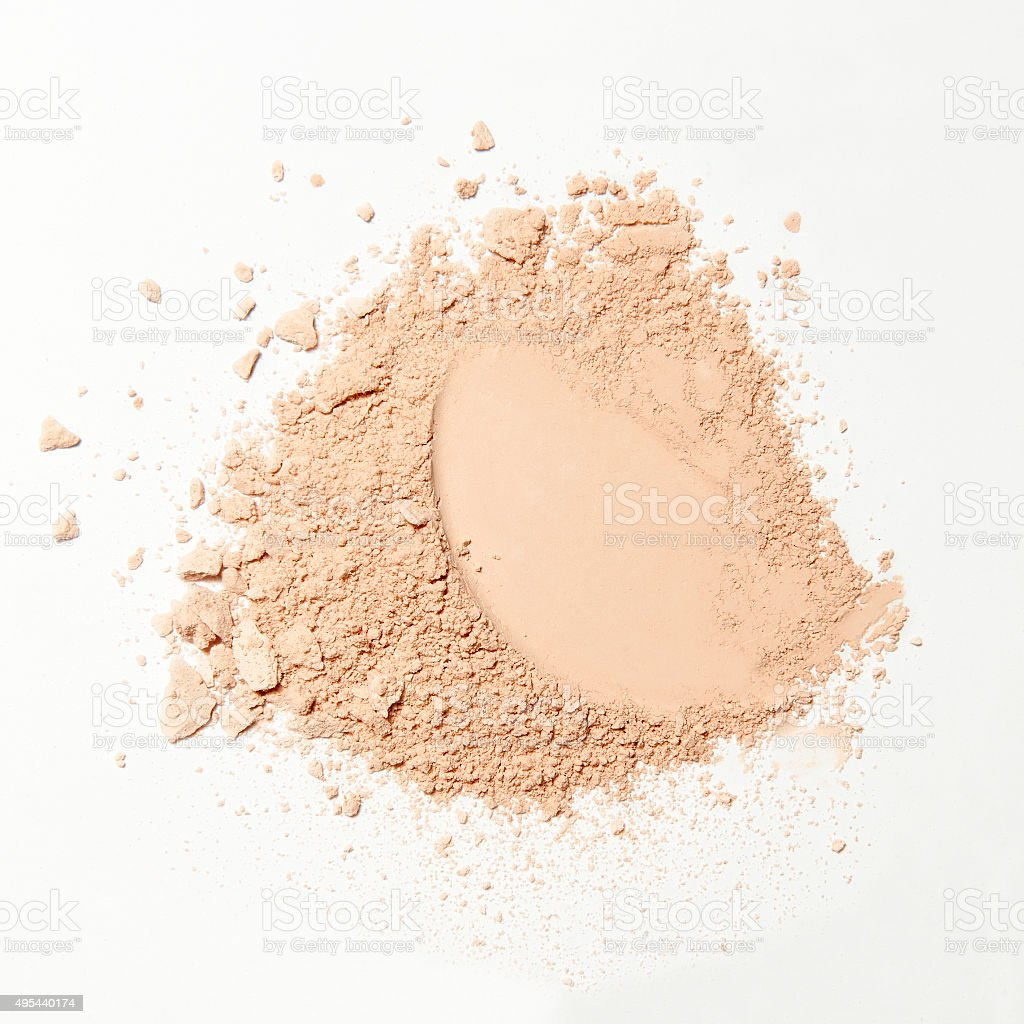 crumbled natural powder on white background stock photo