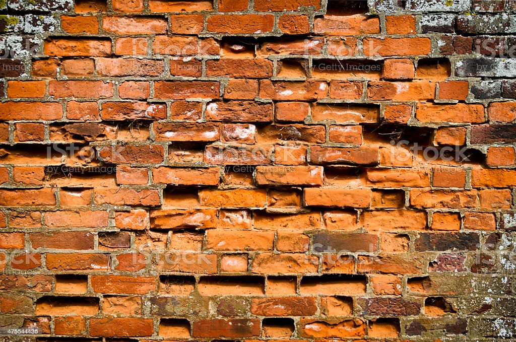 Crumbling brick wall stock photo