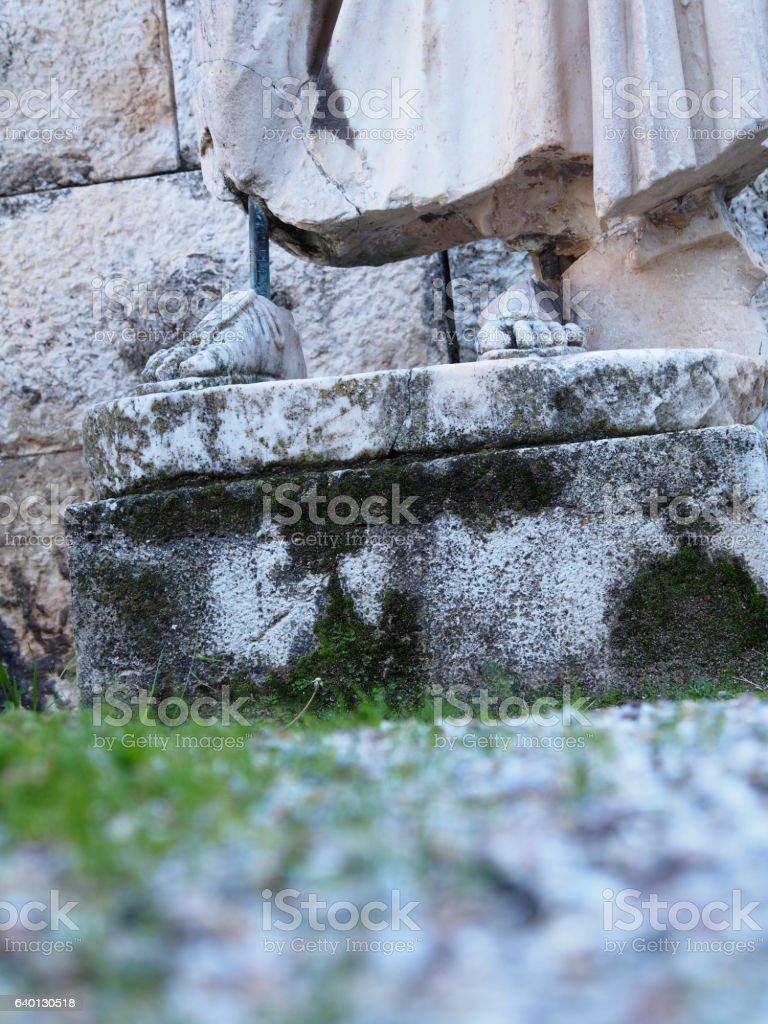 Crumbling Greek statue (detail) stock photo
