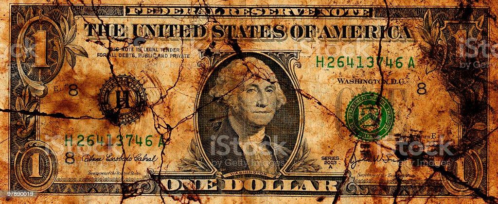 Crumbling U.S. Dollar stock photo
