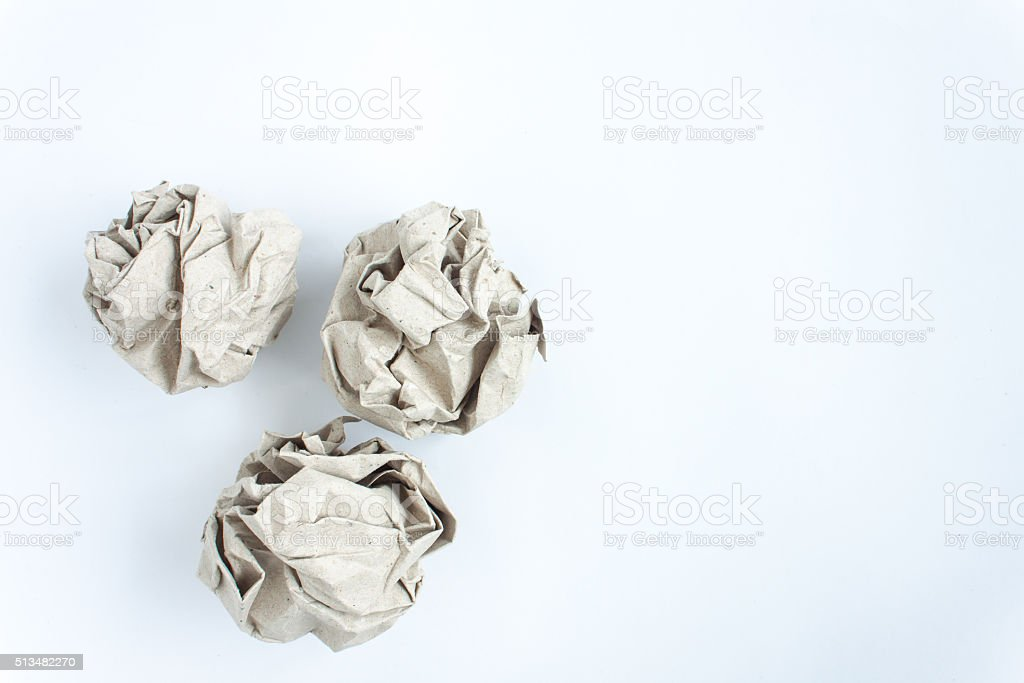 crumled paper on white background, close up, soft focus stock photo