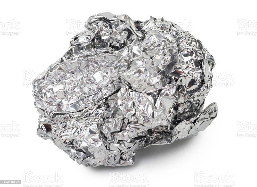 Crumpled ball of aluminum foil stock photo